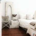 White bedroom with suitcases