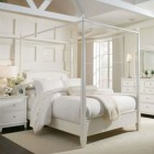 All white bedroom. Love the use of the backpaneling and the dresser.
