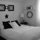 Black and white bedroom. Love the headboard with the frames