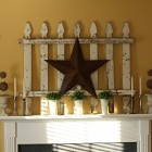 Creative use of a white picket fence and big barn star.