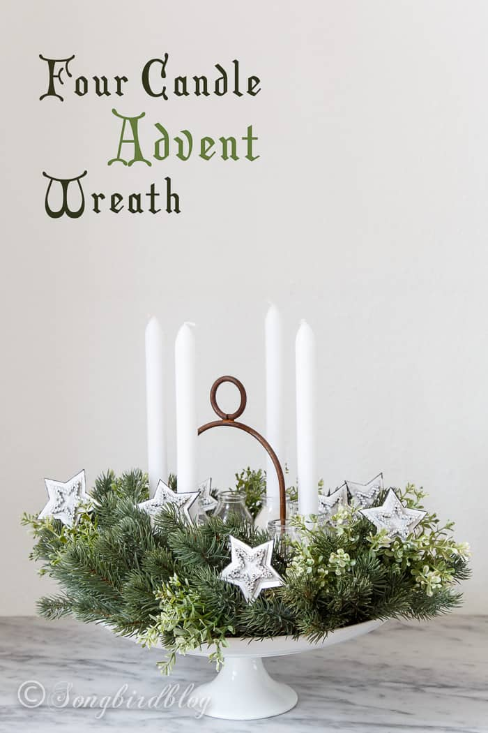 An easy to do Advent wreath idea using a faux wreath and bottles as candle holders.