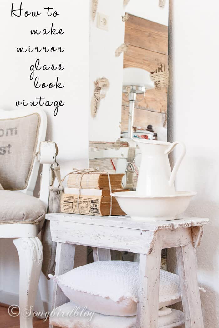decorative corner with vintage looking mirror and an old bench with accessories
