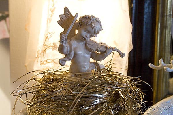vintage Christmas angle in a nest of gold tinsel