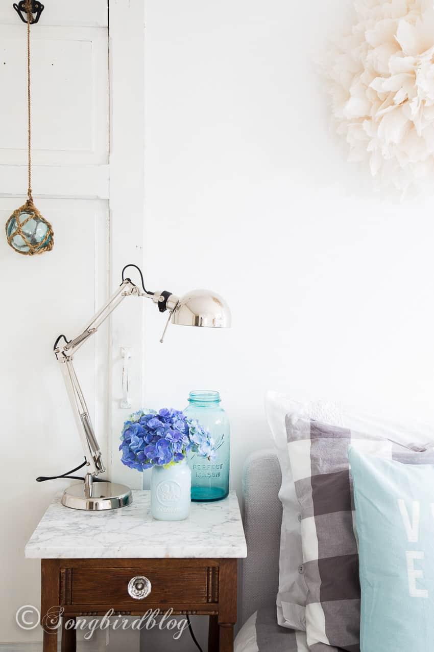 Coastal bedroom decor in aqua with blue hydrangeas.