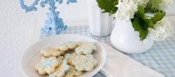 Pretty vignette with cookies and a blue candle stick