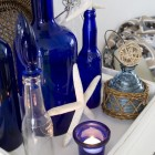 decorative display for summer with blue glass and beach accents