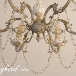paint, crystals and sheet music makeover of a vintage chandelier