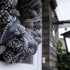 pine cones and ribbon in brown and silver Christ wreath on my front door