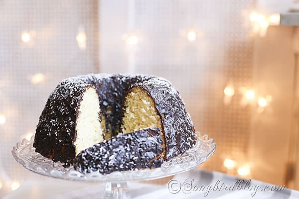 Delicious Coconut Cake Recipe perfect any time of the year, but especially at Christmas http://www.songbirdblog.com