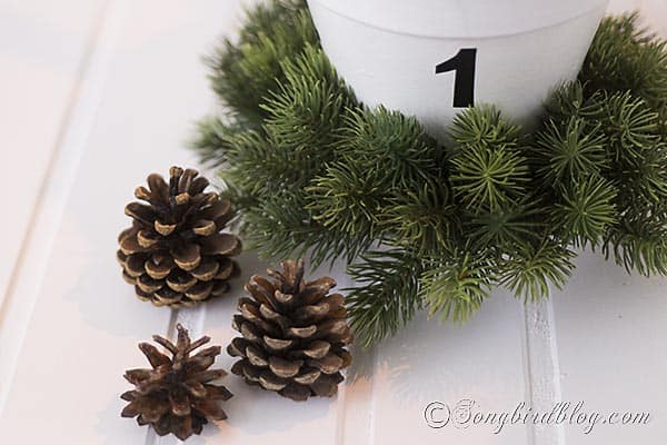 Christmas decorations with pinecones and wreath