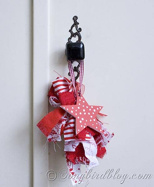 homemade fabric and paper decoration for Christmas door knob