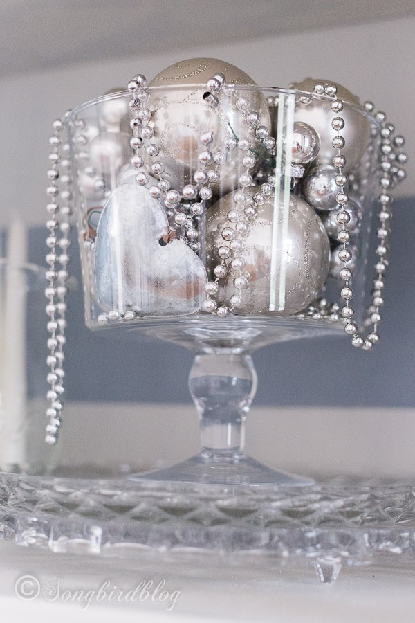 Silver ornaments in a glass bowl