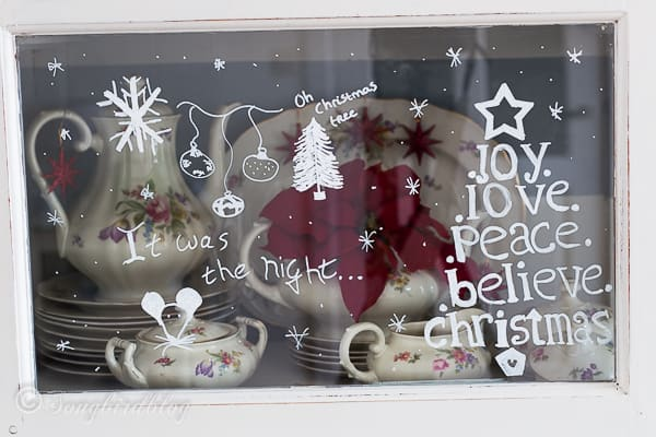 Christmas window decorations on hutch