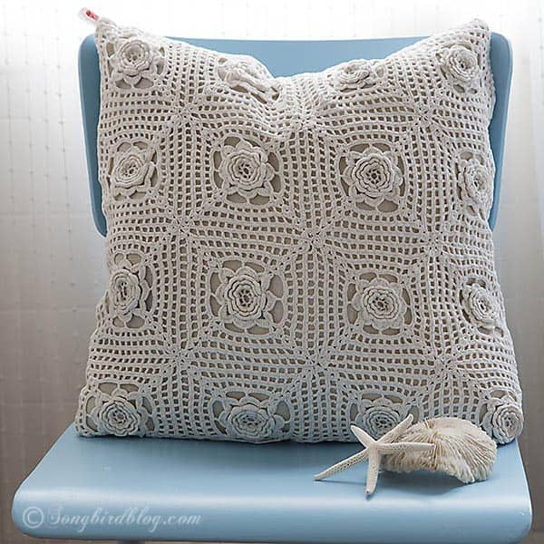 crochet pillow on blue painted school chair