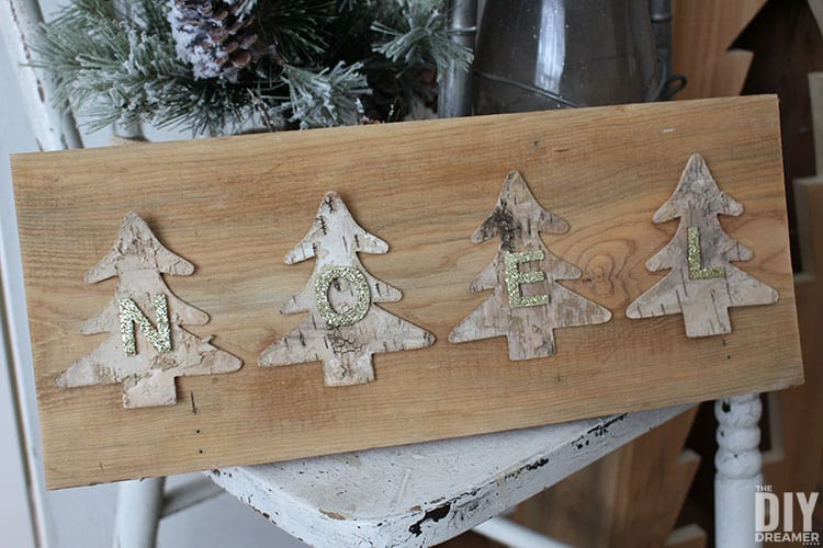Rustic Christmas sign with birch bark Christmas trees.