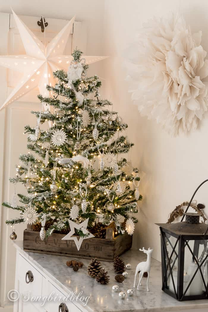 Flocking a thrifted fake Christmas tree, is a great way to make it look stunning and special. And it's easy! See how I did a DIY flocked Christmas tree.