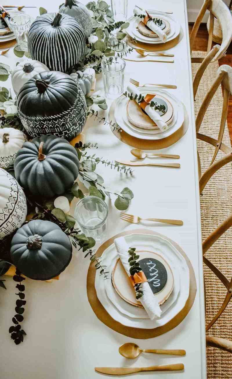 painted pumpkins and a modern table setting for Fall
