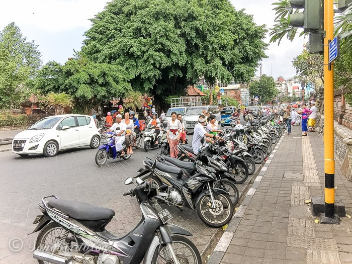 Holiday in Bali. Denpasar street view with mopeds