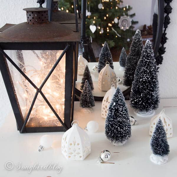 winter Christmas landscape with lantern and lights