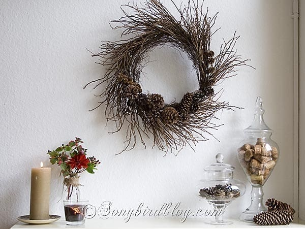 Fall mantel decoration pinecones glass jars twig wreath