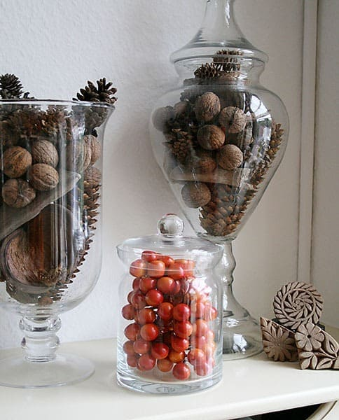 Fall mantel decoration pinecones glass jars