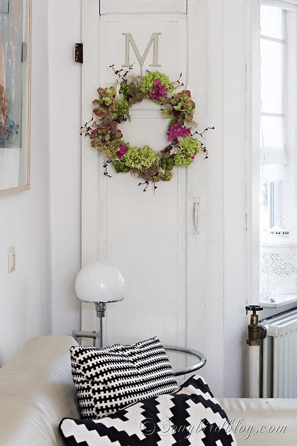 A romantic Fall wreath that is made with flowers and berries from the garden