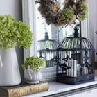 Fall mantel decoration with a wreath on a vintage French mirror, bird cages, vintage books and hydrangea flowers. Via http://www.songbirdblog.com (9)
