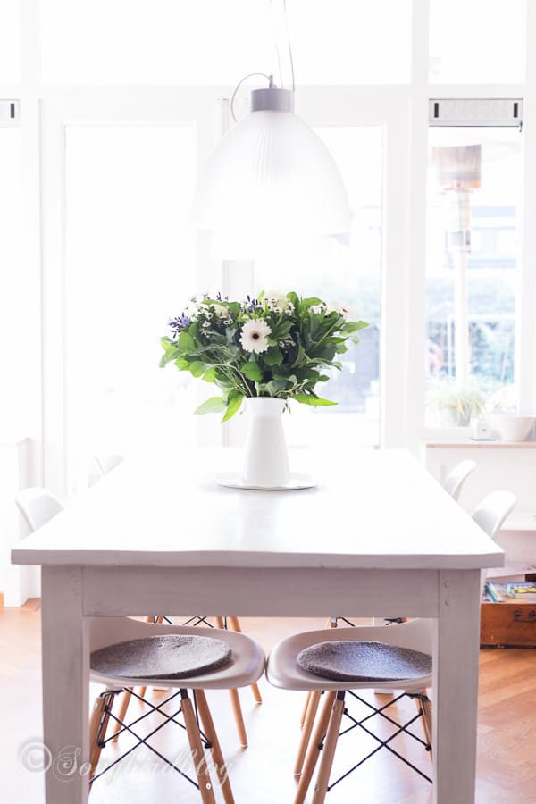 This farmhouse table makeover with milk paint was just what I and my living room needed. I love how bright and cheerful my home looks now.