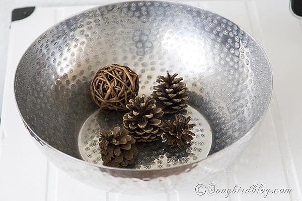 Furniture project Ikea Lack tv stand makeover hack silver bowl pinecones http://www.songbirdblog.com