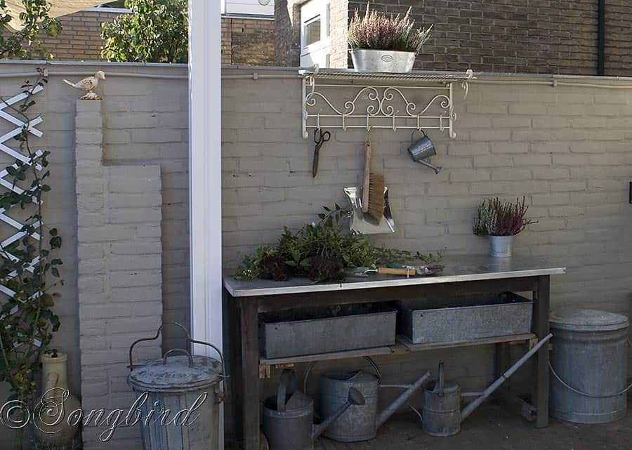 Vintage Coat Rack Finishes A Garden Work Area With A Work