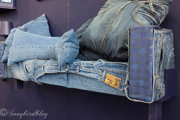 """design trend: re-use and upcyle. Turn old jeans into a couch. Image captured at the """"Woonbeurs Amsterdam"""" a residential living event"""
