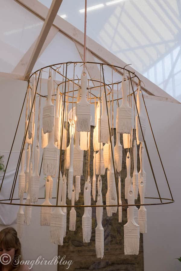 """design trend: homemade quirky chandelier. Great idea to dip paint brushes and use them in a chandelier. Image captured at the """"Woonbeurs Amsterdam"""" a residential living event"""