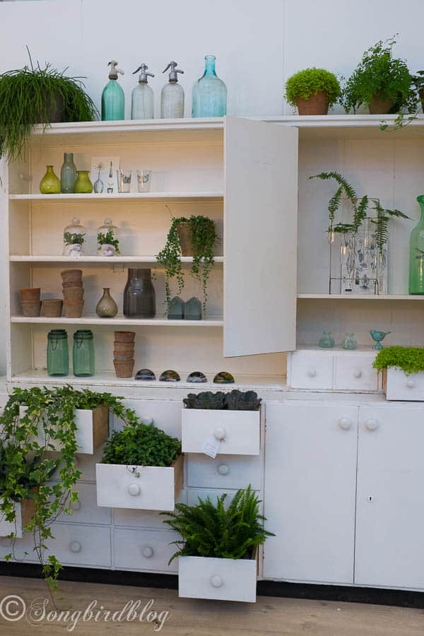 "design trend: use natural elements in your decor. Love the combination of plants and furniture. Totally see this as a herb garden idea. Image captured at the ""Woonbeurs Amsterdam"" a residential living event"