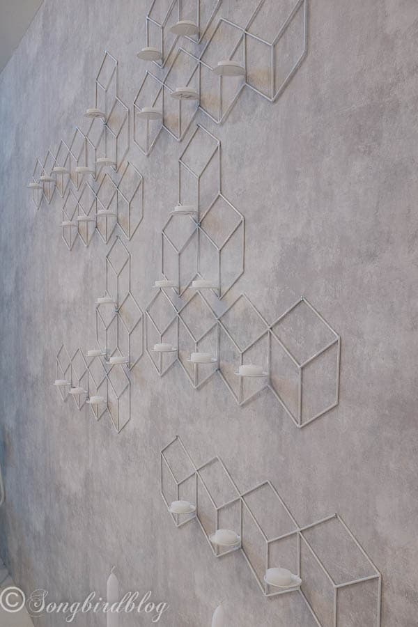 """design trend: geometric patterns. These wall candle lights really make a statement. Image captured at the """"Woonbeurs Amsterdam"""" a residential living event"""
