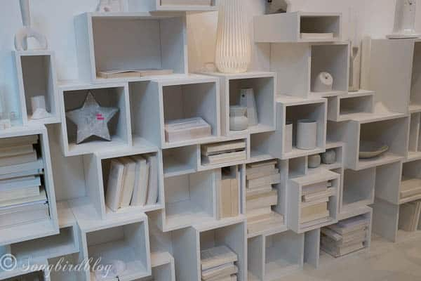 """design trend: monochromatic color. This cubicle wall is such a great take on traditional book shelves. Image captured at the """"Woonbeurs Amsterdam"""" a residential living event"""