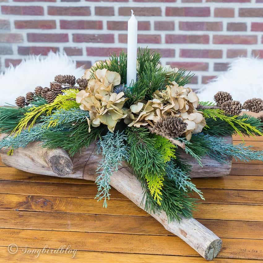 Christmas centerpiece made on a wood log