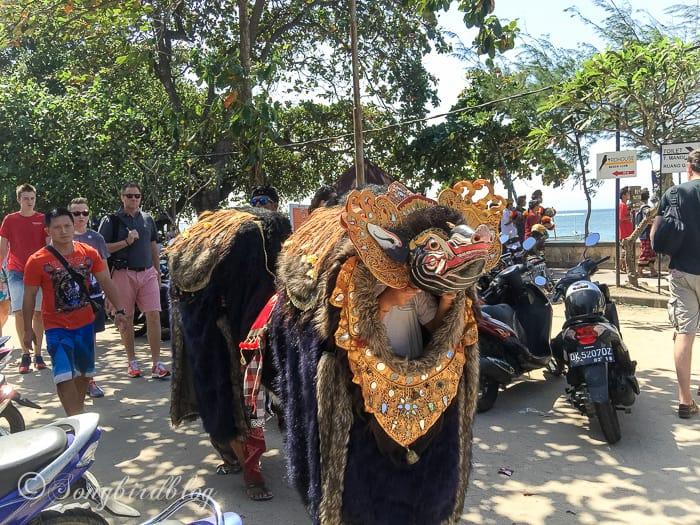 Holiday in Bali. Sanur beach, young men Hindoe dragon