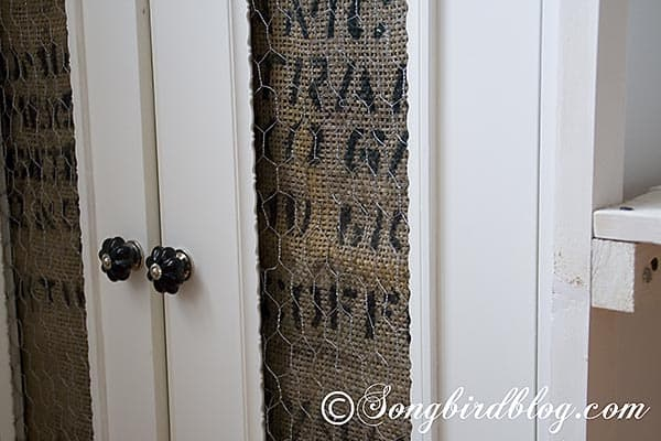 Ikea cupboard makeover with coffee sack burlap and chicken wire