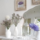mantel decoration with purple and white flowers