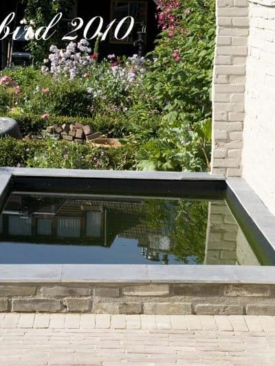 brick garden shed turned into a concrete pond.