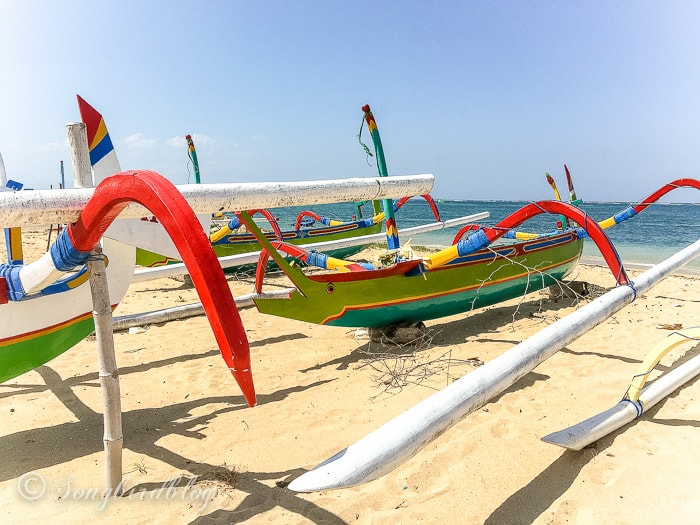 Holiday in Bali. Sanur beach, colorful fishing boats
