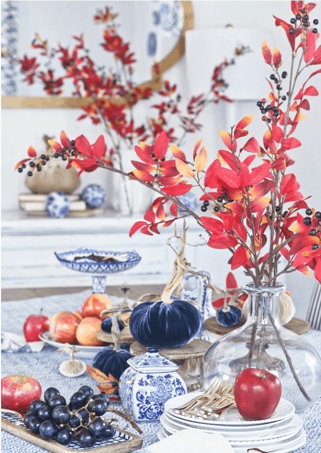 Fall table decor in blue and white with red touches