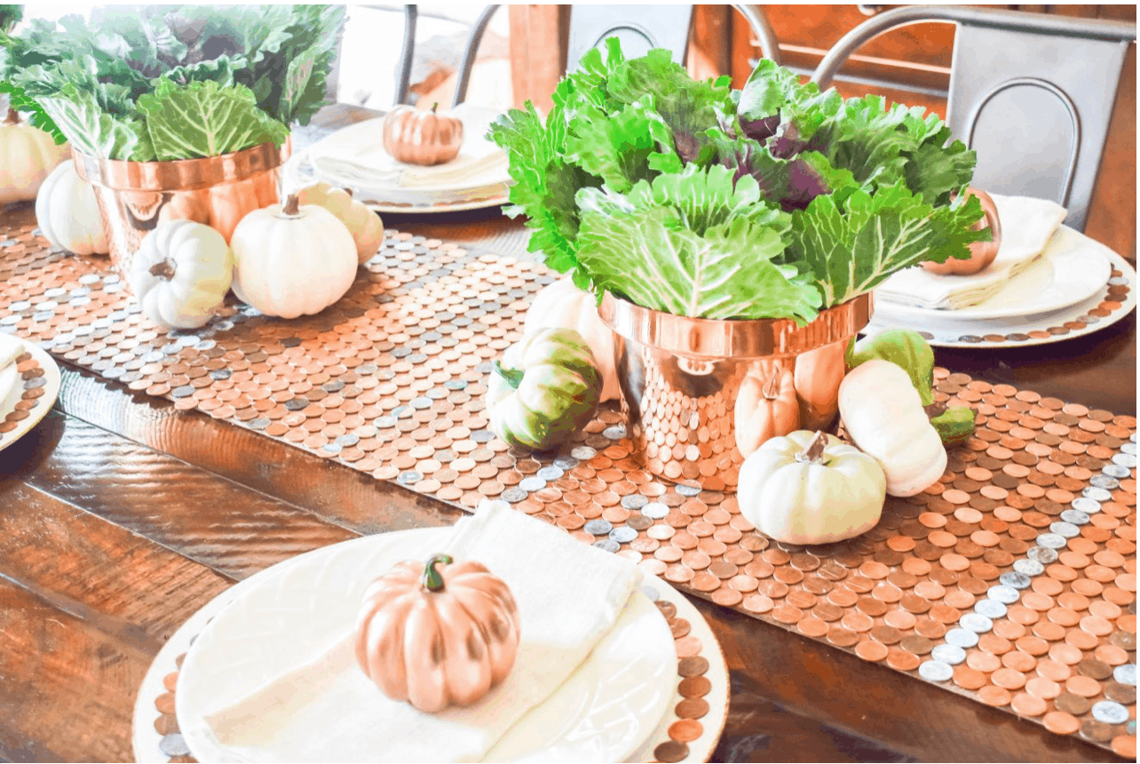 fall table decor with a runner made with pennies