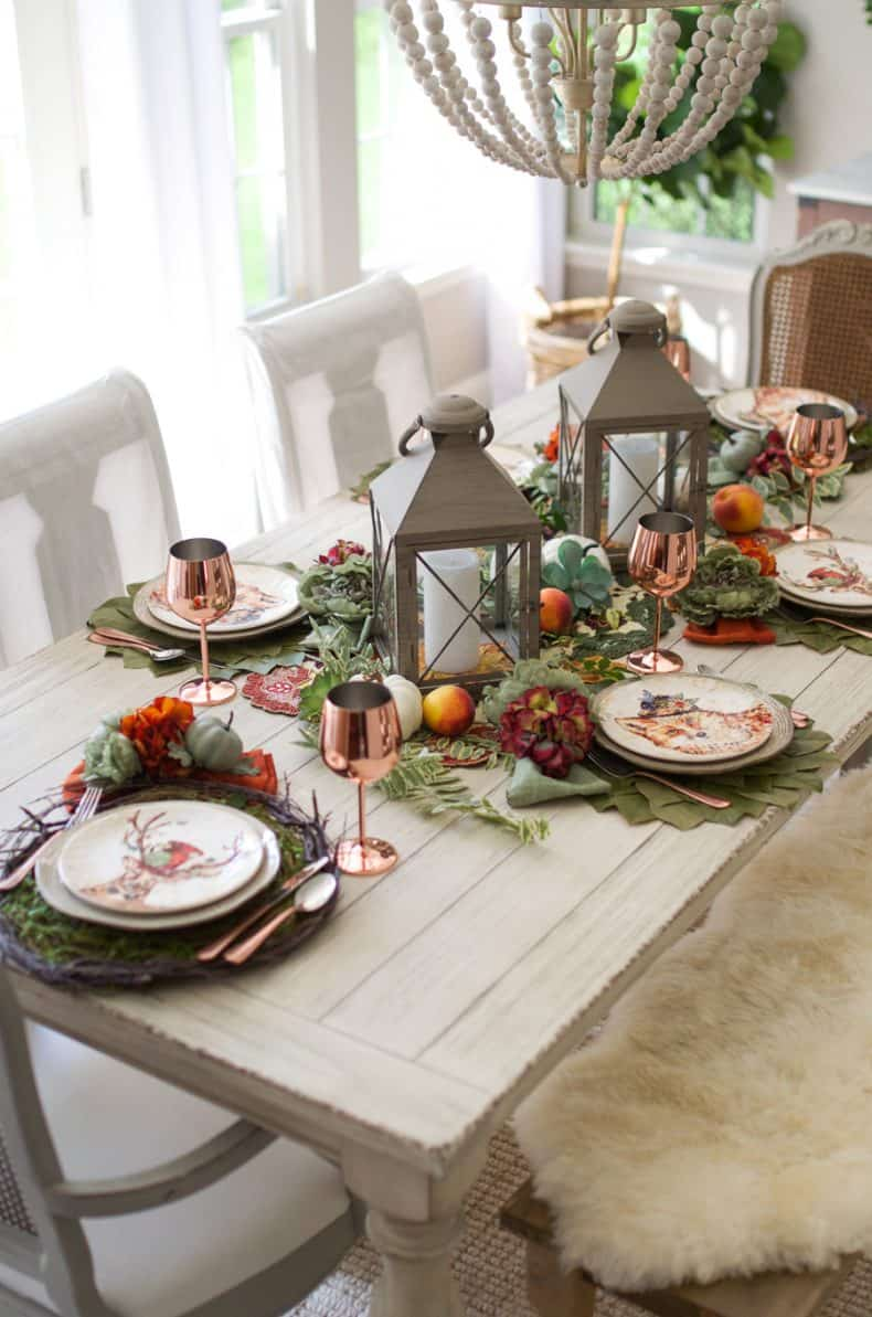 Farmhouse Fall table setting with copper details and rustic lanterns