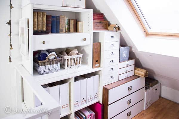 Use every bit of room underneath your sloped walls to create more attic storage space by stacking cabinets, book shelves and drawer units until all the space is utilized.