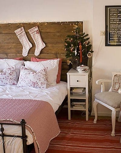 Christmas decorating in bedroom with stockings