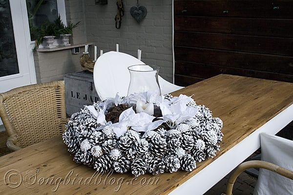 pine cones wreath centerpiece garden table Christmas decorating outdoors