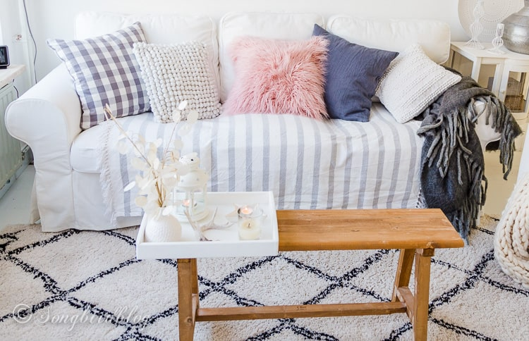 white couch with pastel and grey accessories