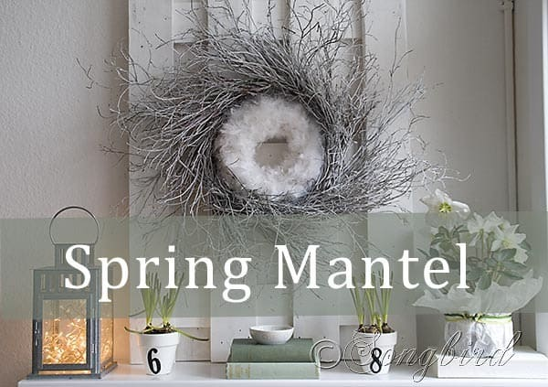 Lovely Spring mantel idea: twig wreath combined with a feather wreath and with fresh flowers and greens.