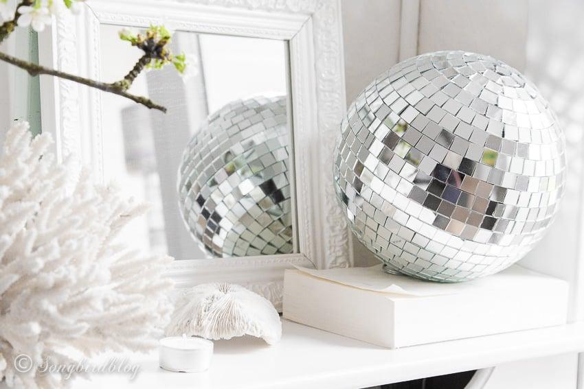 Disco ball on white ledge